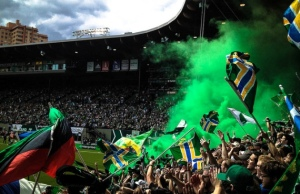 The Portland Timber's largest supporter group, the Timber's Army, in Providence Park during the Great Northwest Derby against the Sounders.