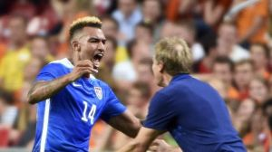 Zardes (left), hugs Head Coach Jurgen Klinsmann (right), scored his first international goal against the Netherlands, as did Bobby Wood and Danny Williams.
