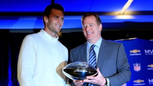 Tom Brady receives the Super Bowl XLIX MVP trophy from Roger Goodell after the Patriots defeated the Seahawks.