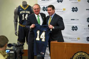 Under Armour CEO Kevin Plank (right) announces the deal worth $90 million over the span of 10 years with University of Notre Dame with the school's athletics director, Jack Swarbrick.