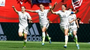 Morgan Brian #14, Carli Lloyd #13, and Alex Morgan #10 celebrate an early goal in the US' victory over Japan on Sunday.