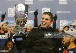 Jay Heaps, Head Coach of the New England Revolution, lifts the Eastern Conference Trophy after beating the NY Red Bull in 2014 to advance to the MLS Finals. Heaps, who was a former wealth management analyst for Morgan Stanley, is very big on statistical data analysis and has hired Tim Crawford to head the Revolution's analytics efforts.
