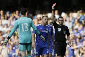 Chelsea defender John Terry is shown a red card in the defending champions' opening game against Swansea.