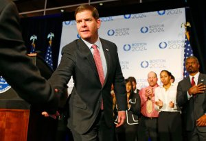 Boston Mayor Marty Walsh shaking hands with a member of the United States Olympic Committee in January after winning the USOC bid selection process.