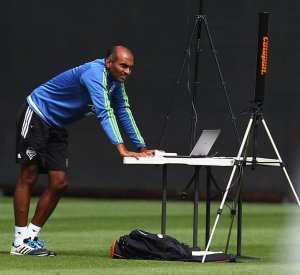 Ravi Ramineni, a sports science data analyst with SoundersFC, works at a station on the practice field as he collects data during a team training session on Wednesday, July 22, 2015, in Tukwila, Wash.  MLS SOCCER - SOUNDERS FC TRAINING REGIMEN - STARFIRE SPORTS COMPLEX, TUKWILA - 148753 - 072215