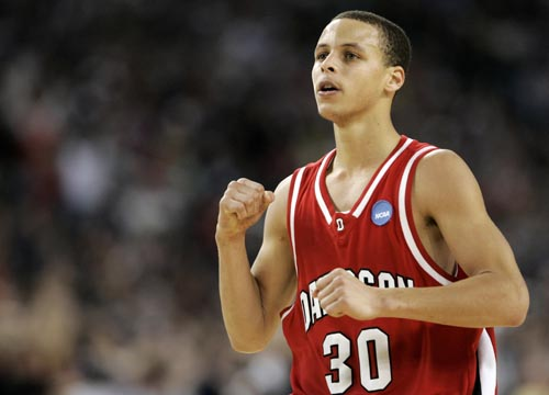 Davidson's Curry celebrates after a three-pointer against Wisconsin during their NCAA basketball game in Detroit